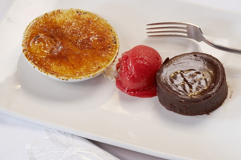 Valrhona soft centre chocolate pudding, white chocolate creme brulee and raspberry sorbet.