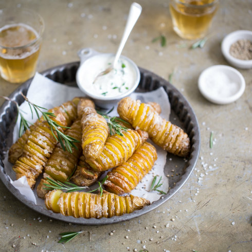 Baked hasselback fingerling potatoes with sour cream and herbs  (photography by Tasha Seccombe, styling by Nicola Pretorius)