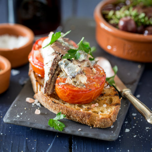 Portuguese sardines and roasted tomatoes on toasted ciabatta (photography by Tasha Seccombe, styling by Nicola Pretorius)