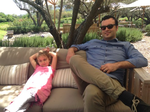 Lounging on the counches under the olive trees outside the Terra del Capo tasting room.