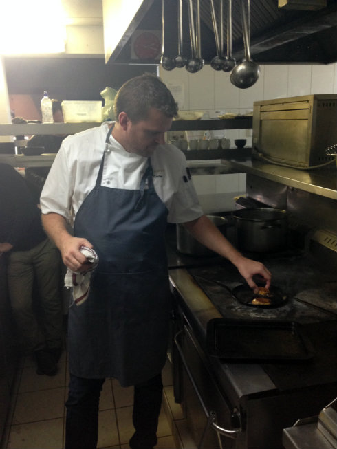 Chef Scot Kirton frying a slab of fois gras to perfection.