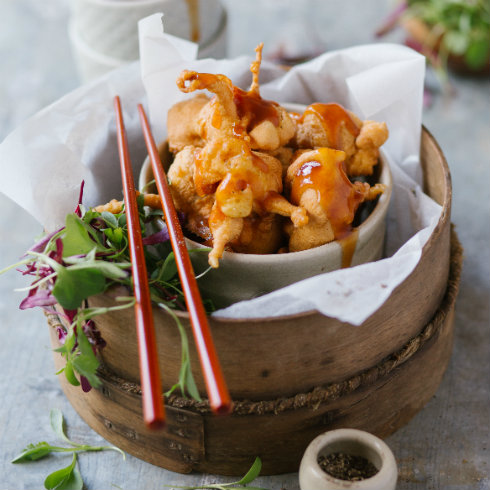 Deep fried pork in a batter, with sweet & sour sauce (photography by Tasha Seccombe)