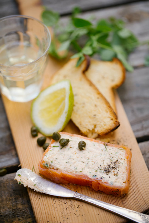 A slice of pale coral trout terrine and melba toast (photography by Tasha Seccombe)