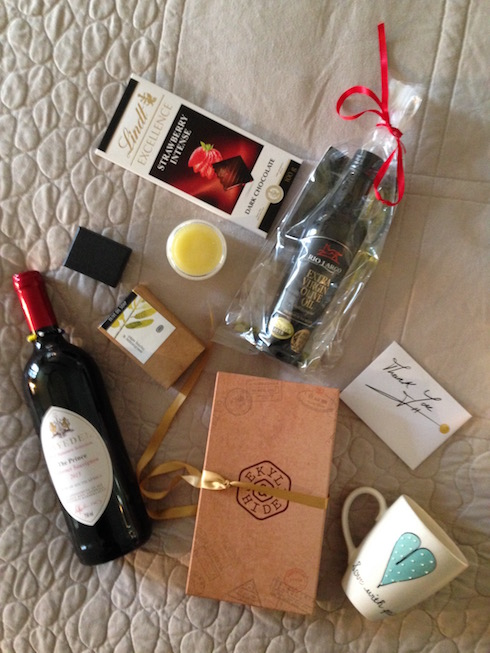 My gift hamper from Miles for Style included silver jewelry, wine, bee balm, chocolate, olive oil, hand crafted soap, a coffee mug and a leather wallet!